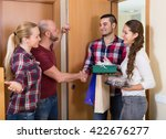 family couple receiving... | Shutterstock . vector #422676277