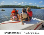 people tubing on an inland lake | Shutterstock . vector #422798113