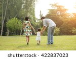 happy asian family walking on... | Shutterstock . vector #422837023