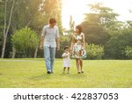 happy asian family walking on... | Shutterstock . vector #422837053