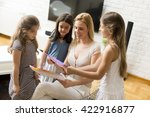 girl showing a drawing to the... | Shutterstock . vector #422916877