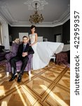 bride sitting in a chair and... | Shutterstock . vector #422959357