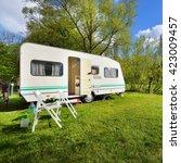 caravan trailer on a green lawn ... | Shutterstock . vector #423009457