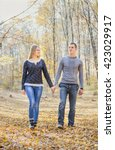 couple in the autumn forest | Shutterstock . vector #423029917