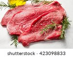 a red meat with rosemary on... | Shutterstock . vector #423098833