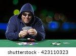 smiling hooded male poker...   Shutterstock . vector #423110323