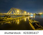 Small photo of The old Binh Loi Bridge by night, Ho Chi Minh City, Vietnam, completed in 1902, including 6 spans 276m long, rail main circulation route Vietnam railway and a road traffic sub 2-wheel, 2-dimensional.