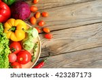 include vegetables on wooden... | Shutterstock . vector #423287173