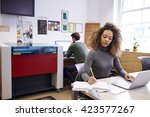 staff in design office with cad ... | Shutterstock . vector #423577267