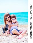 sisters on beach | Shutterstock . vector #423590407