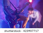 man playing electric guitar on... | Shutterstock . vector #423907717