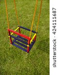 Small photo of swing on an empty playground. Concept for child protection, abduction or loneliness