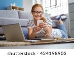 happy young woman studying at... | Shutterstock . vector #424198903