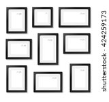 set of empty picture frames on... | Shutterstock .eps vector #424259173