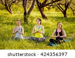 young girls yoga in the park.... | Shutterstock . vector #424356397