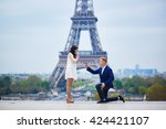 romantic engagement in paris ... | Shutterstock . vector #424421107