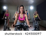 young woman on bikes indoors | Shutterstock . vector #424500097