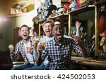 shouting fans with a beer at a... | Shutterstock . vector #424502053