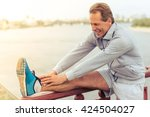 handsome middle aged man in... | Shutterstock . vector #424504027