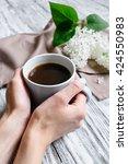 cup of coffee in hands   Shutterstock . vector #424550983