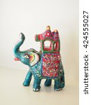 Small photo of blue elephant figure with a pink palanquin on the back