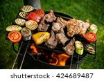 meat and vegetables on the grill | Shutterstock . vector #424689487