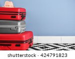 suitcases with hat on blue wall ... | Shutterstock . vector #424791823