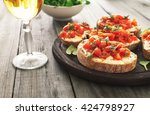 bruschetta with tomatoes  goat... | Shutterstock . vector #424798927