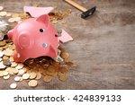 Broken Piggy Bank With Cash An...