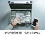 Businessman With Money And...