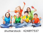 happy kids with painted hands... | Shutterstock . vector #424897537