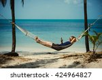 a young man relaxes in a... | Shutterstock . vector #424964827