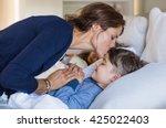 Mother Giving Good Night Kiss...