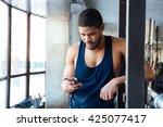 fitness afro american man using ...   Shutterstock . vector #425077417
