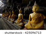 buddha in cave | Shutterstock . vector #425096713