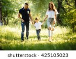 happy family running in the park | Shutterstock . vector #425105023