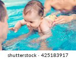 Cute Baby Boy Swimming With...