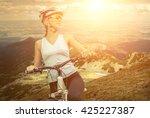 beautiful woman in helmet and... | Shutterstock . vector #425227387