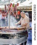 Small photo of EL ALAMO, MADRID, SPAIN - APRIL 30, 2016: Chef working in the biggest medieval street markets of Europe