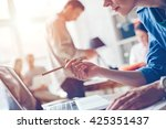 woman in open space office.... | Shutterstock . vector #425351437