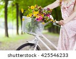 woman holding a vintage bicycle ... | Shutterstock . vector #425546233