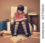 a little child girl is reading... | Shutterstock . vector #425743033
