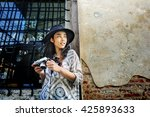 photographer travel sightseeing ... | Shutterstock . vector #425893633