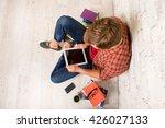 young smart man siting on floor ... | Shutterstock . vector #426027133