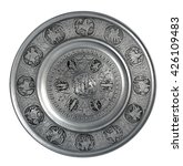 Small photo of Silver colored pewter decorative plate Adam and Eve in the Garden of Eden isolated on a white background