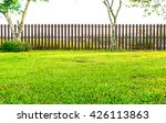 Brown Fence With Green Grass I...