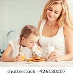 child with mother drinking milk.... | Shutterstock . vector #426130207