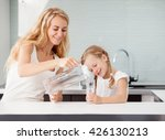 child with mother drinking... | Shutterstock . vector #426130213
