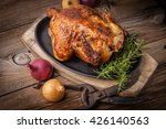 Roasted Chicken On A Spit On...