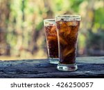 Small photo of glass of cola with ice cubes,Drink Soda.